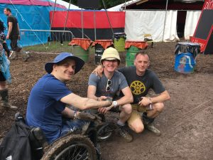 Andy Barrow thanking two men for their help at Glastonbury.