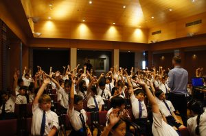 Engaged students with hands up