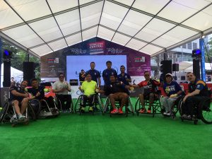 a group photo after trying wheelchair rugby at the Hong Kong Sevens in 2017