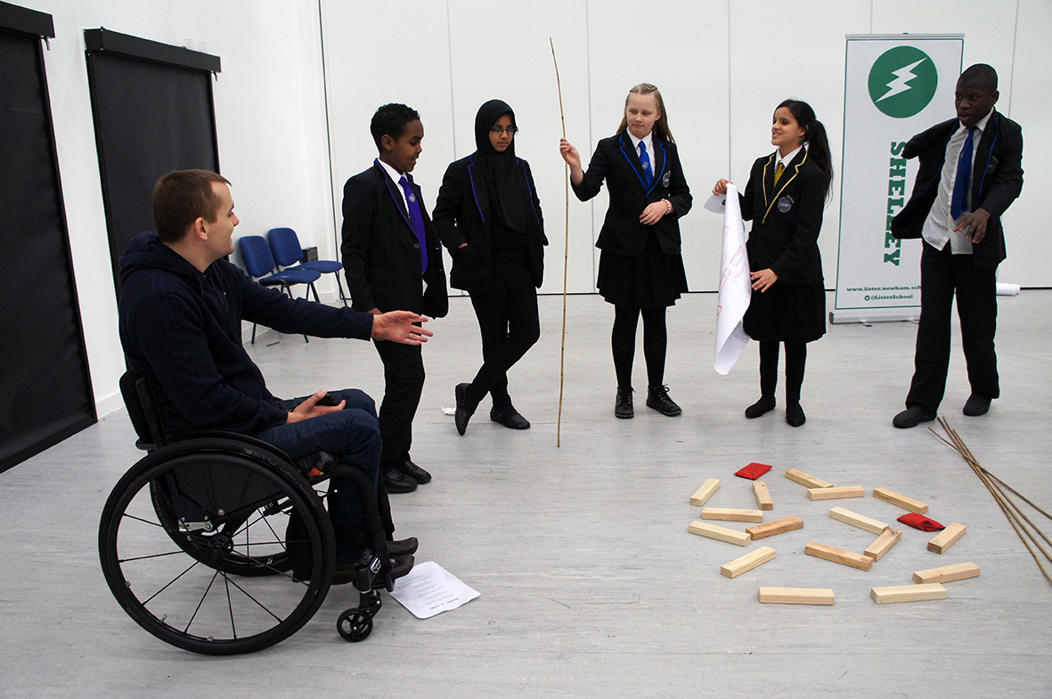 Andy Barrow mentoring students at a secondary school